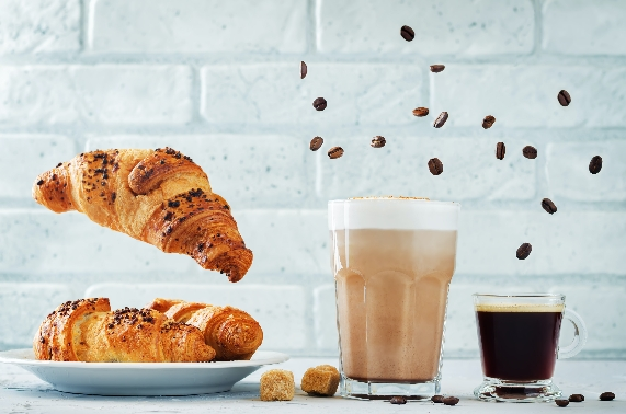 different-types-of-coffee-with-flying-croissants-e-PVKBHA2